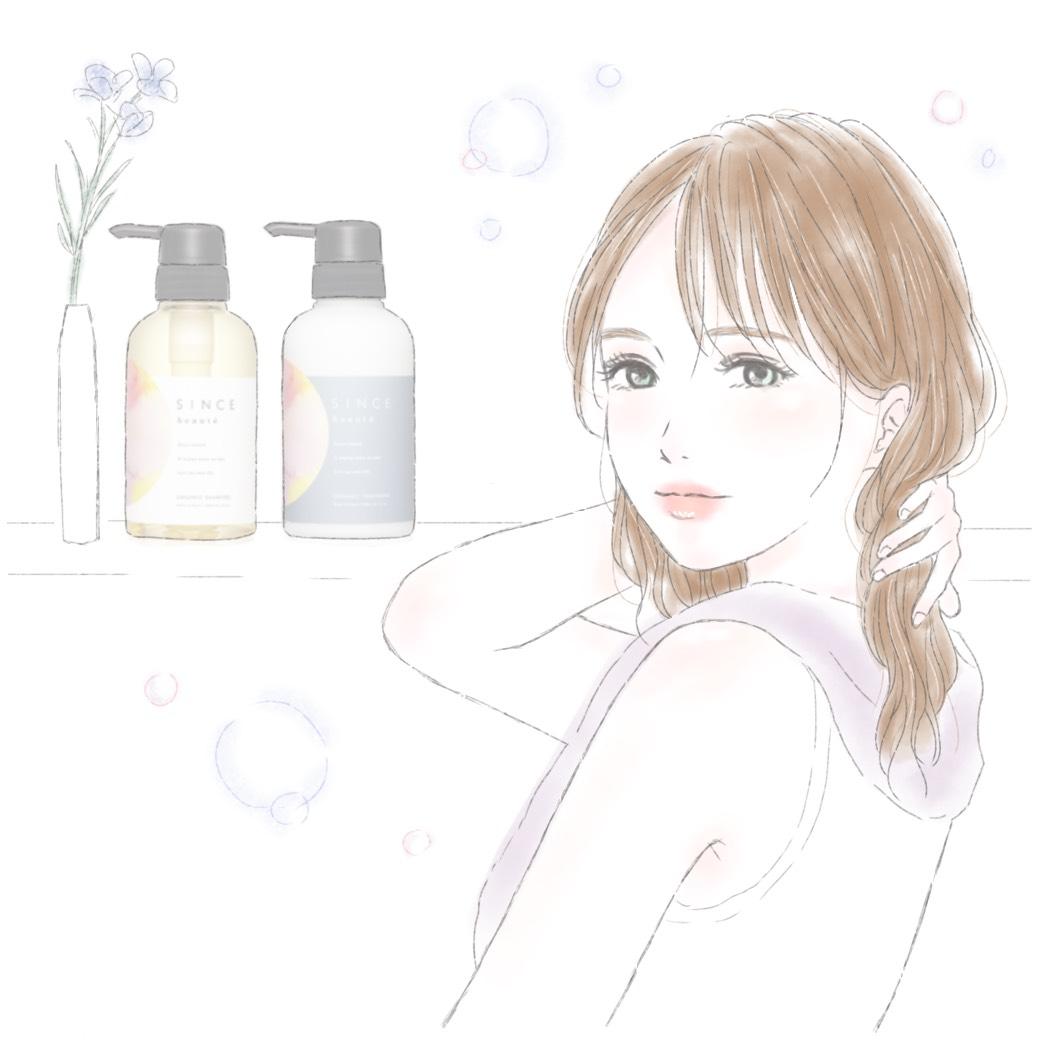 バスルームで髪を触る女性
