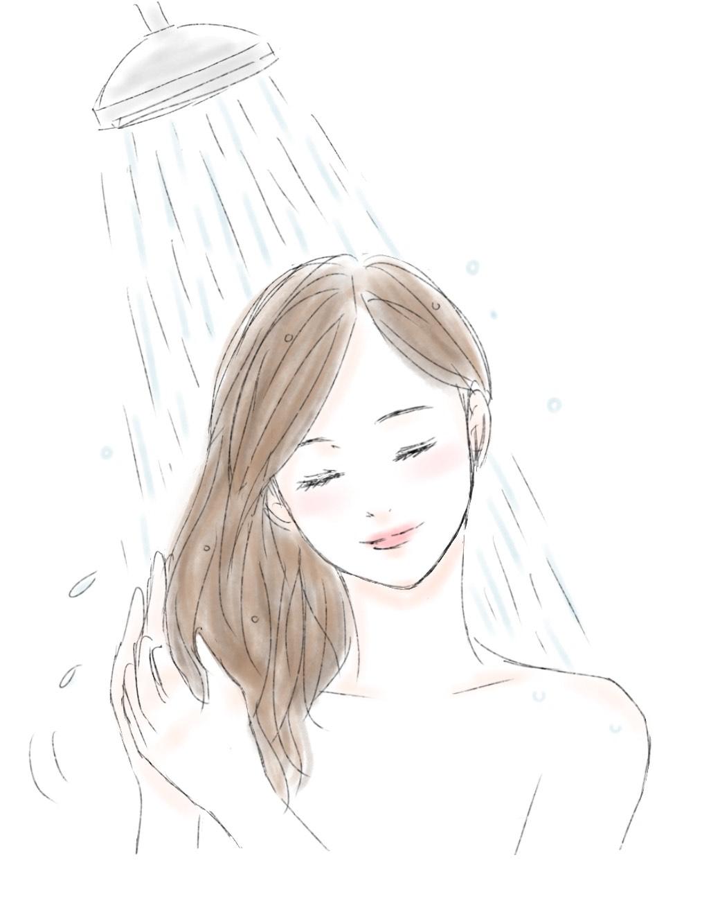 シャンプーをする前に髪の湯洗いをする女性